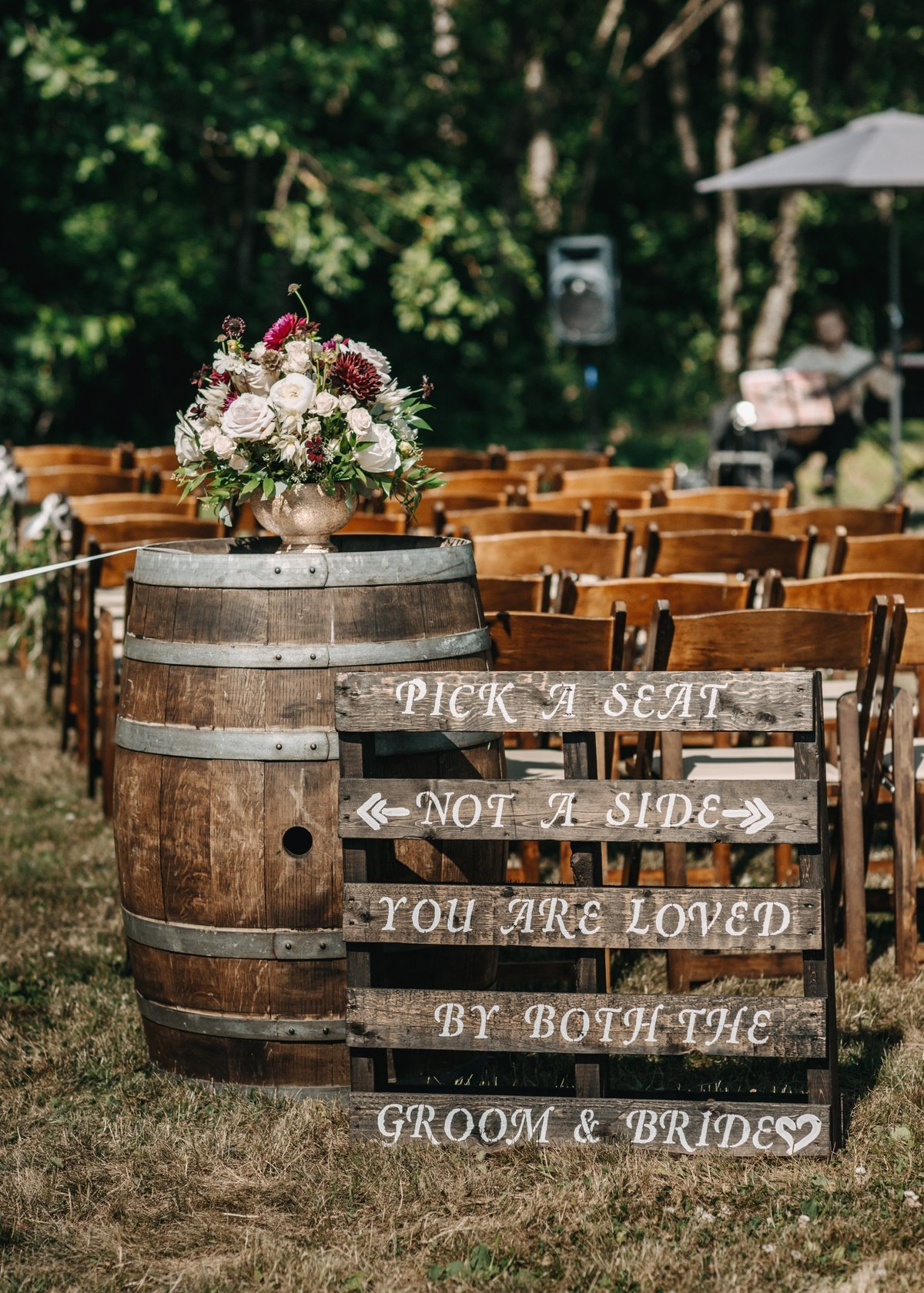 wine barrel wedding flower arrangement