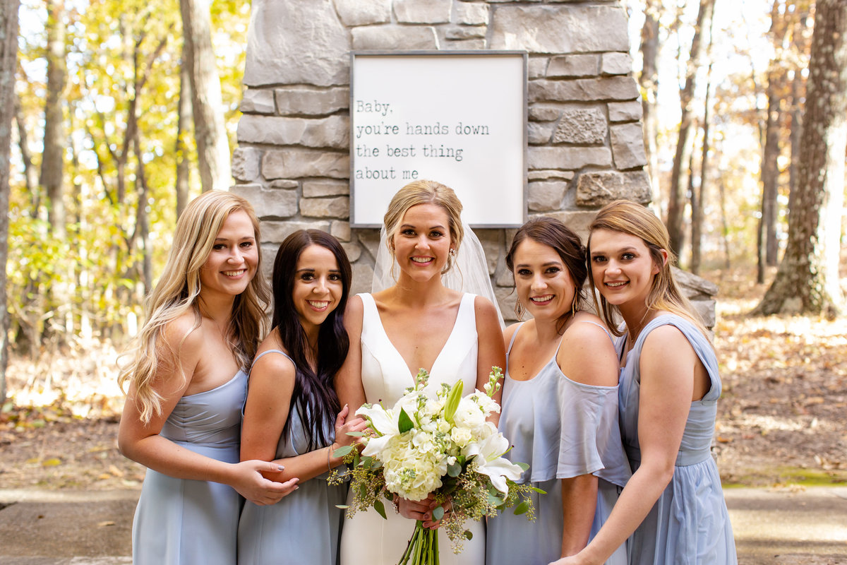 Romantic Fall Elopement  bride and bridesmaids in slate blue dresses by fireplace at Greensfelder County Park  in St. Louis  by Amy Britton Photography Photographer in St. Louis