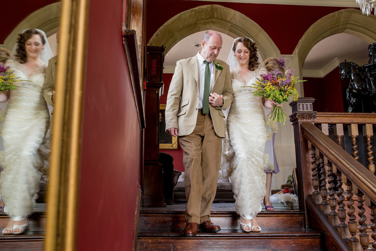 Bride and Dad walking to ceremony at Huntsham Court Devon