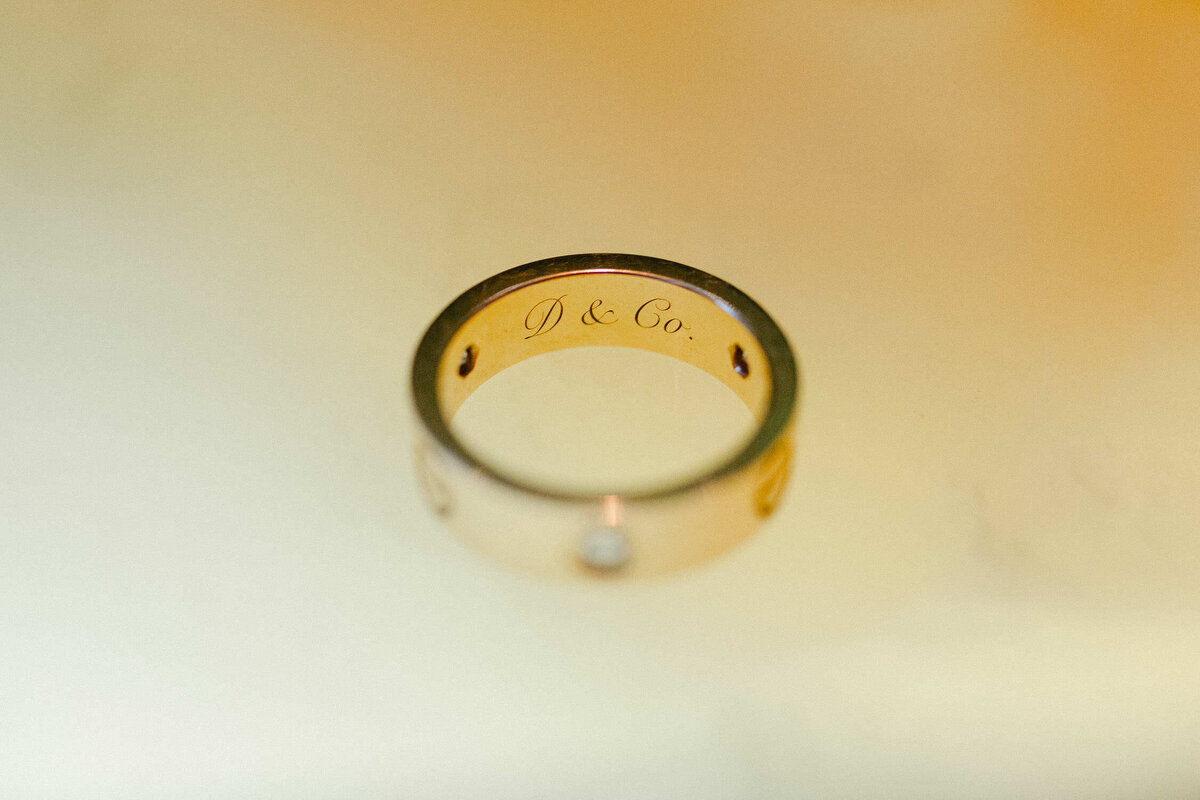 carved inscription inside gold Cartier wedding band
