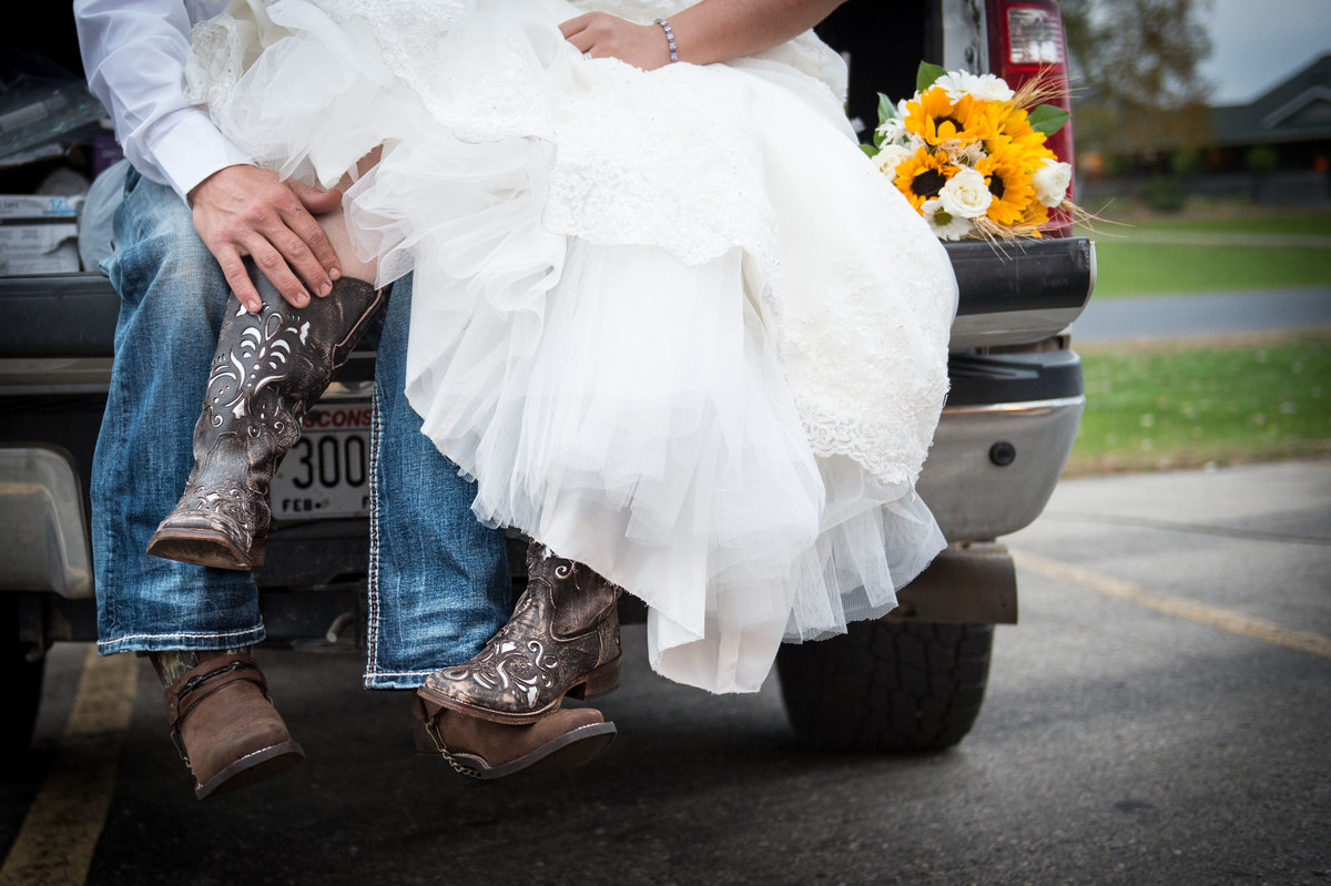 bride wears cowboy boots under dress-foot photo