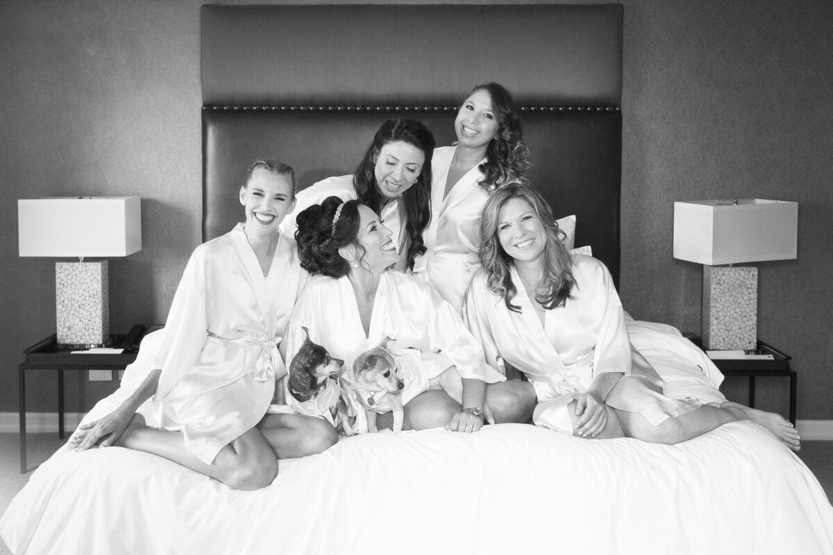 bridesmaids on a bed