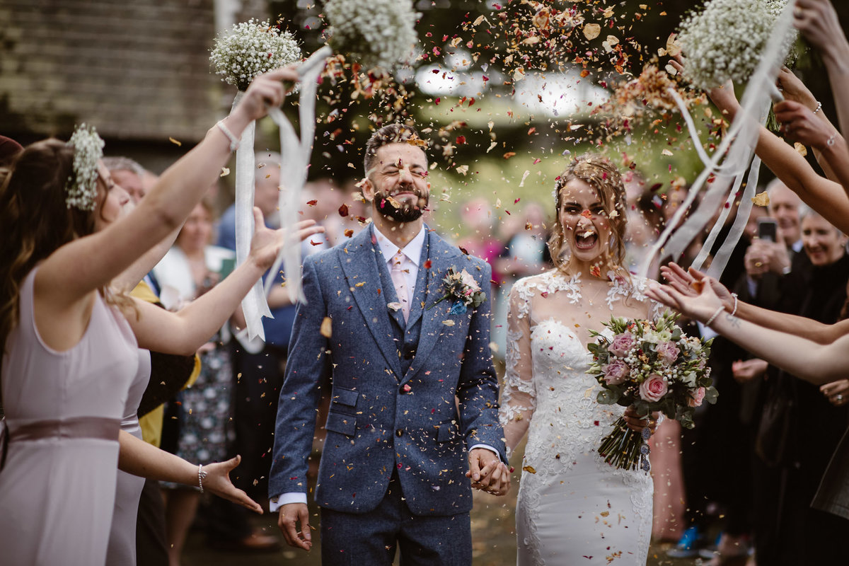 Bride & Groom showered in confetti by Wedding Photographer Jono Symonds