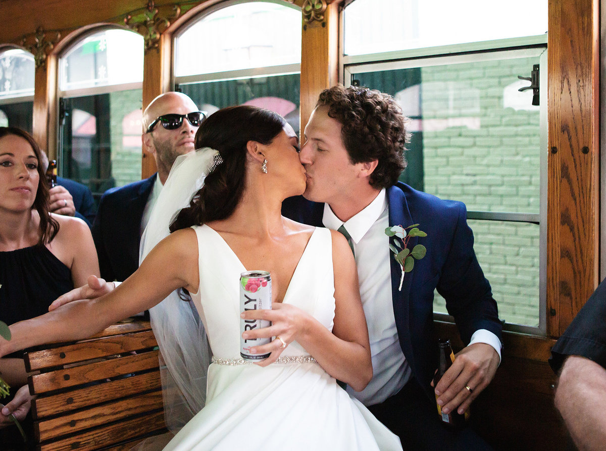 bride-and-groom-kissing-in-a-streetcar