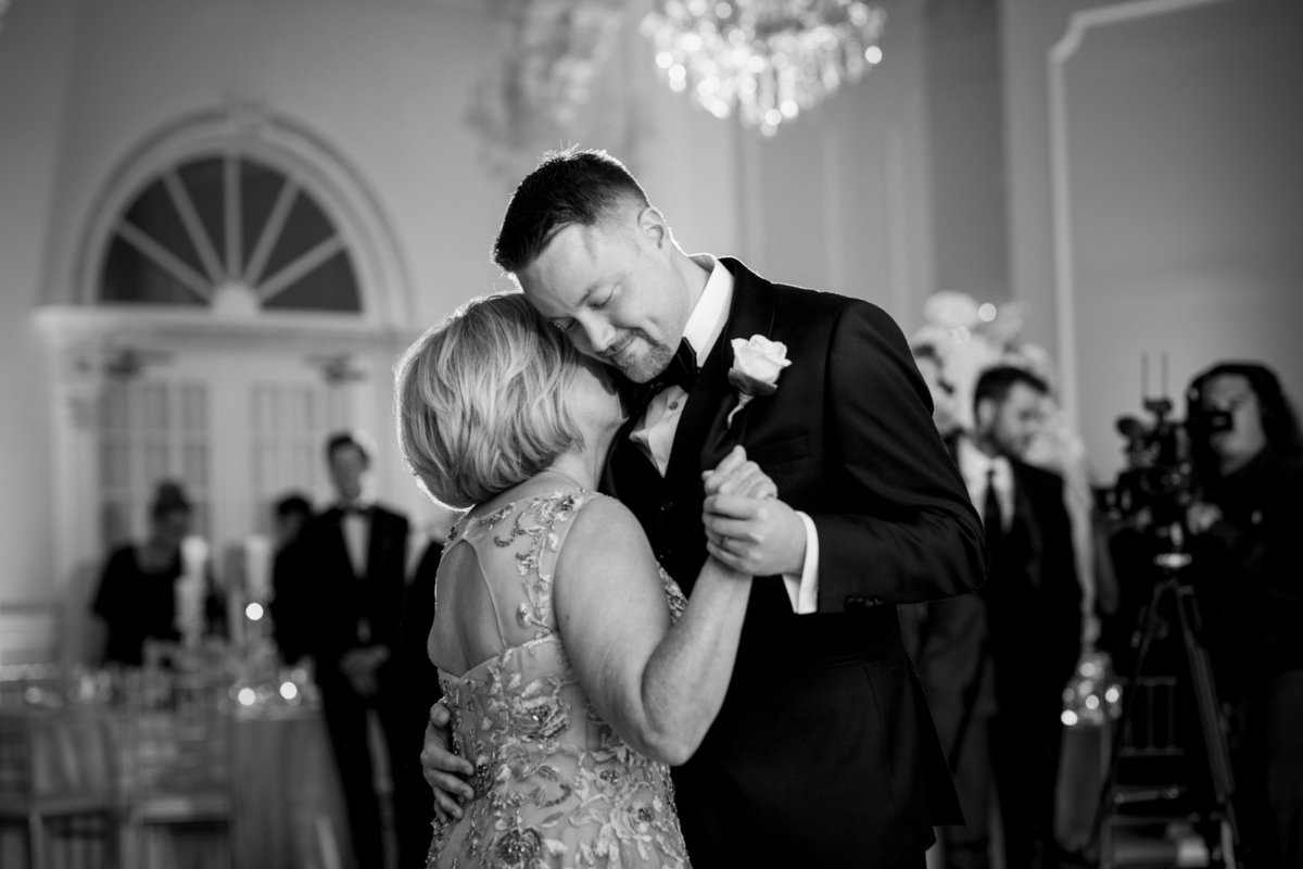 groom dancing with mom at addison park wedding