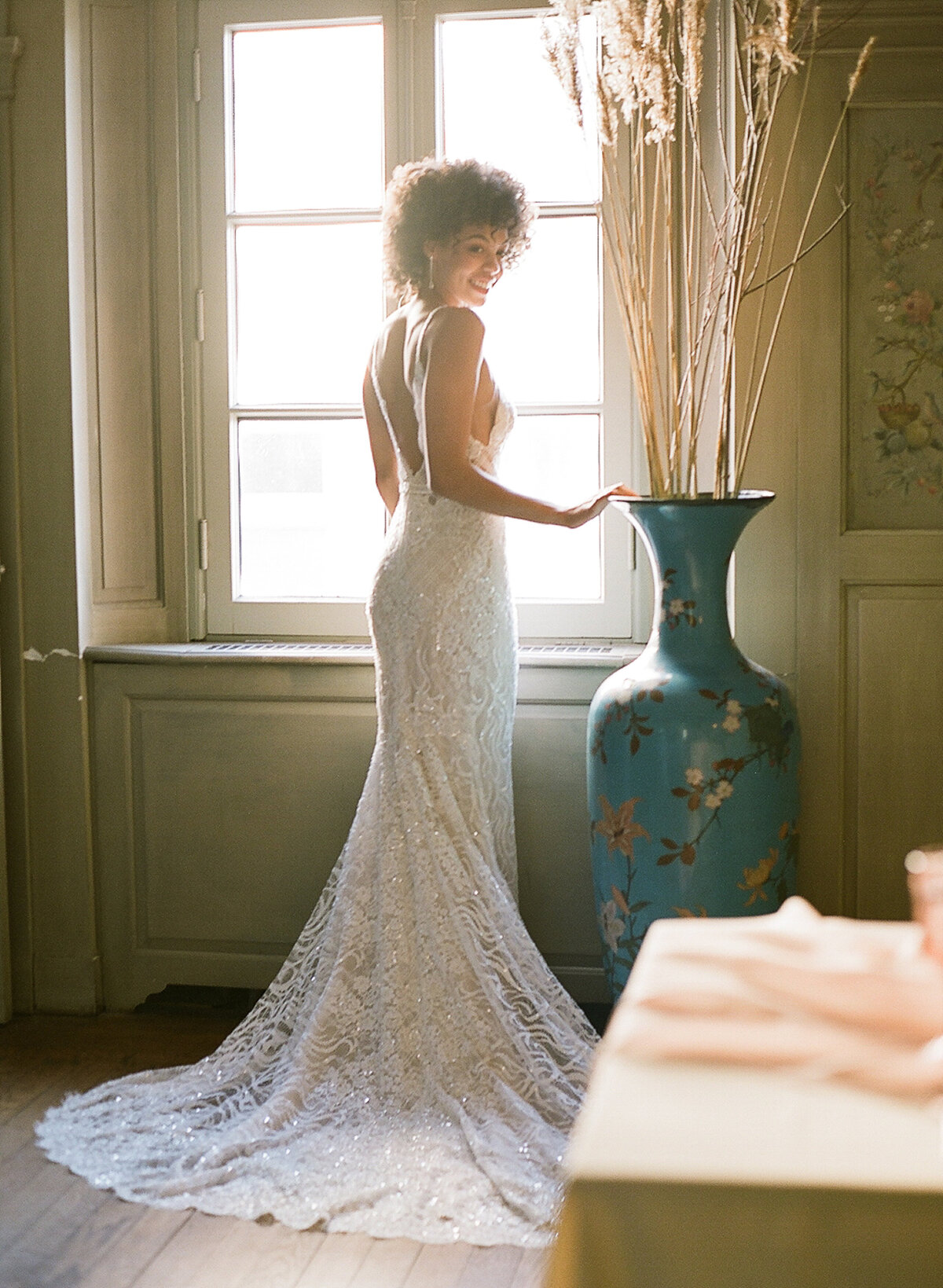 Bride posing in window after destination wedding