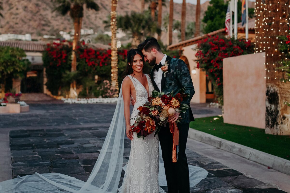 Bride and Groom Cuddle during sunset photos at Royal Palms wedding