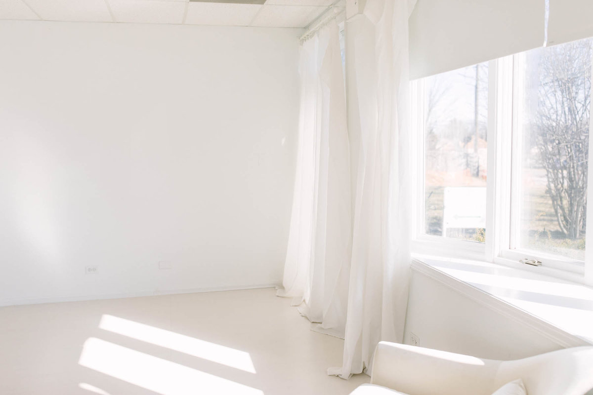 Laurie Baker with Elle Baker Photography offers a peek into her beautiful natural light studio setup