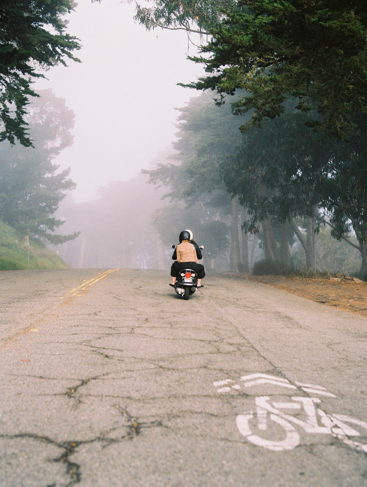 Couple riding vespa photo in San Francisco, California -vespa-fog-Lands End