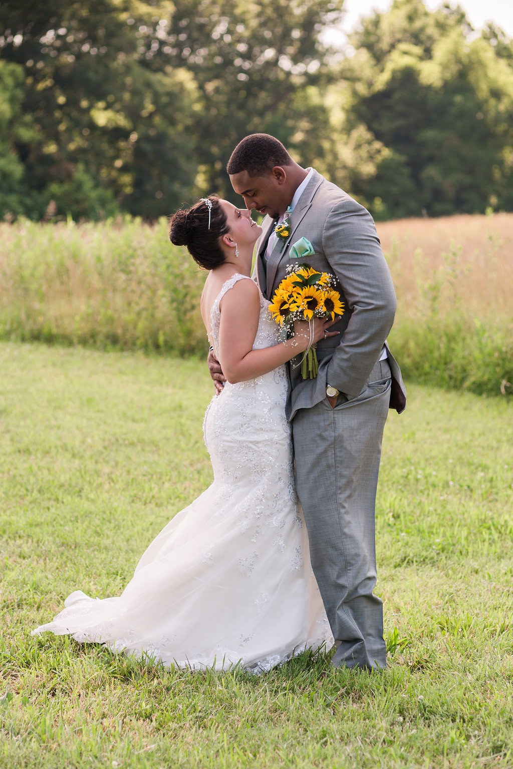 A bride and groom in front of a field in Spotsylvania