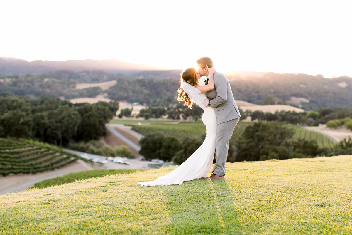 Couple kissing at sunset at Opolo Vineyard wedding in Paso Robles, Ca