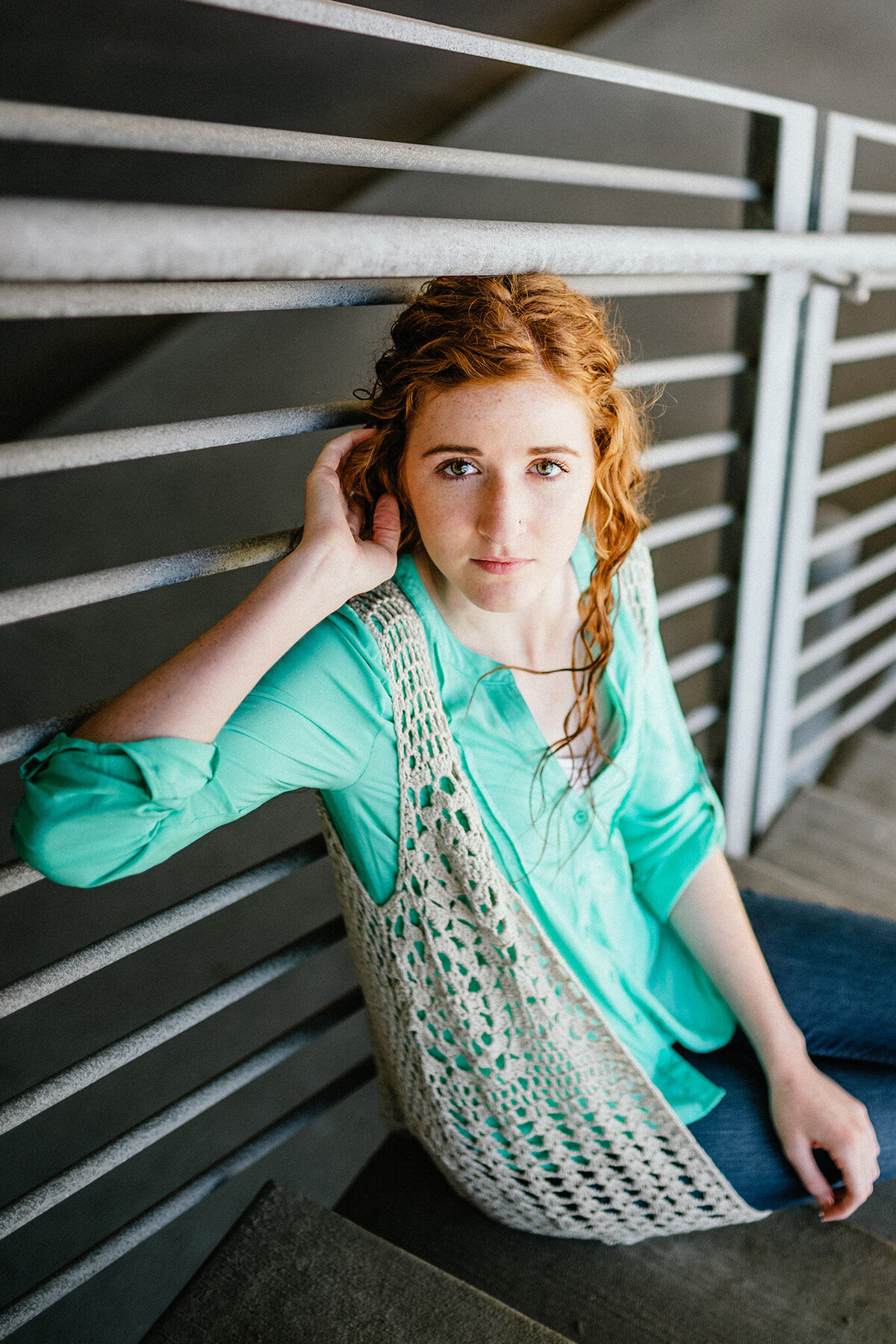 a senior girl poses in a parking garage in des moines