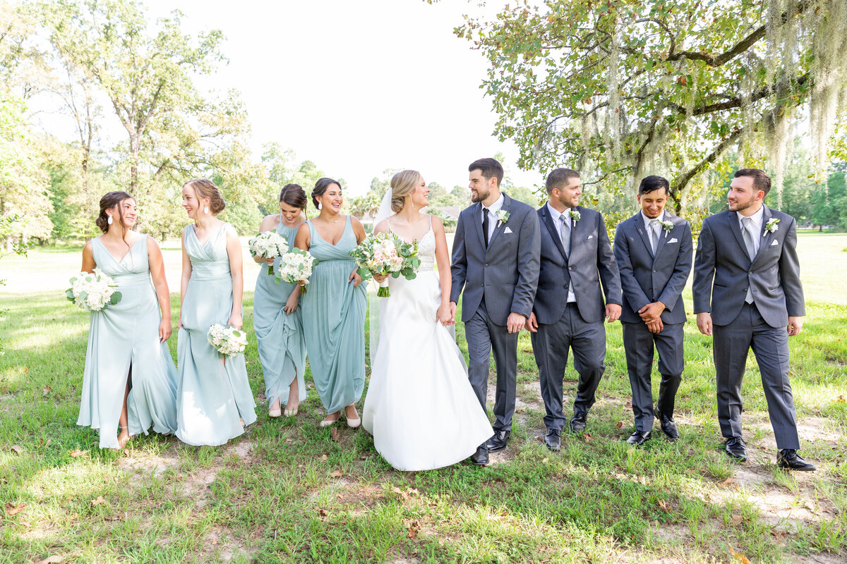 Wedding Party Having Fun Walking in Green Field