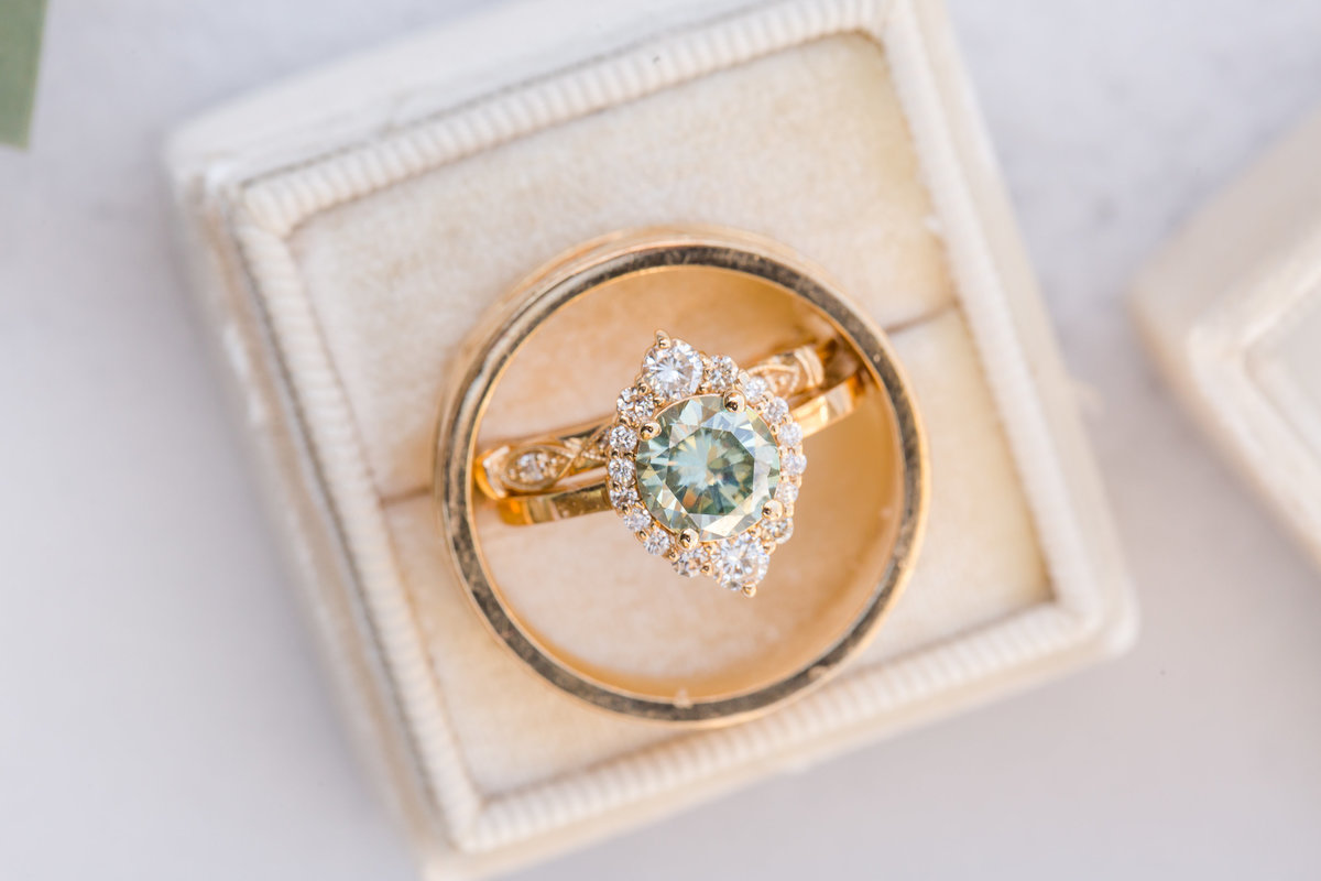 A beautiful mint wedding ring sits in a box at a Wintergreen Resort shoot