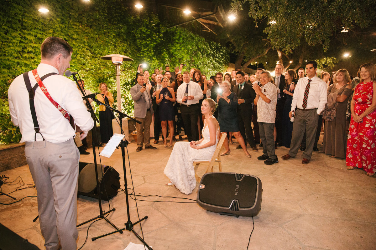 Groom sings song to bride at Firestone Vineyard wedding