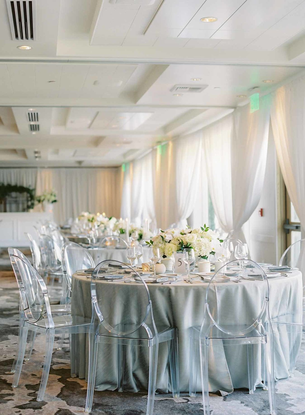 Luxury grey and white wedding reception designed by Flora Nova Design Seattle