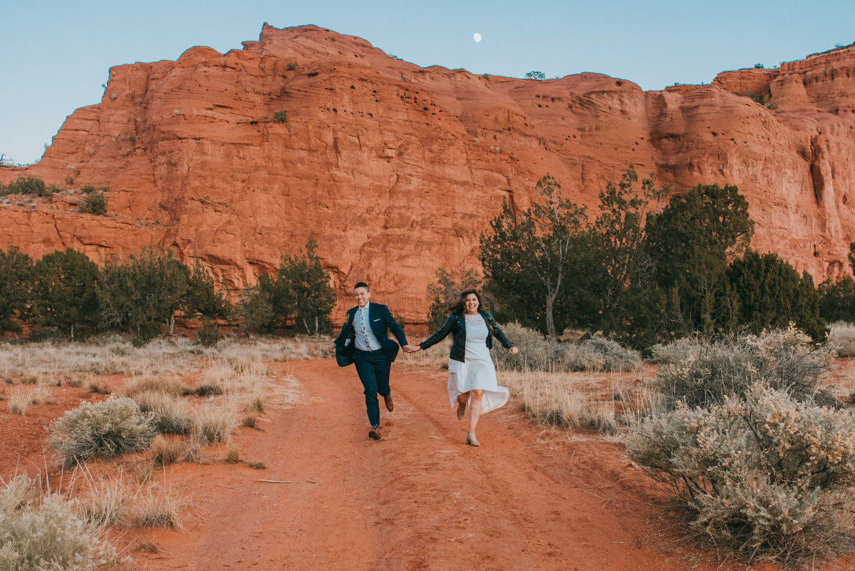Adventurous couple eloping in New Mexico red rock desert