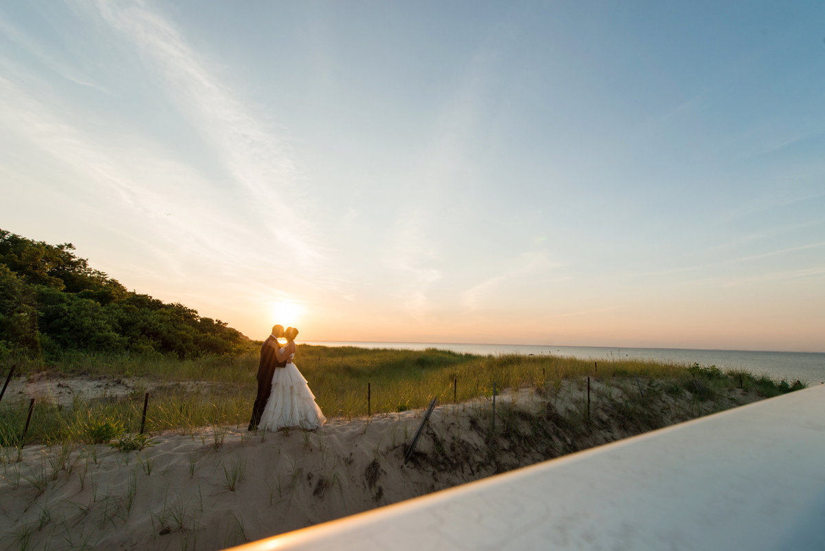 distant photo bride and groom from wedding at Pavilion at Sunken Meadow