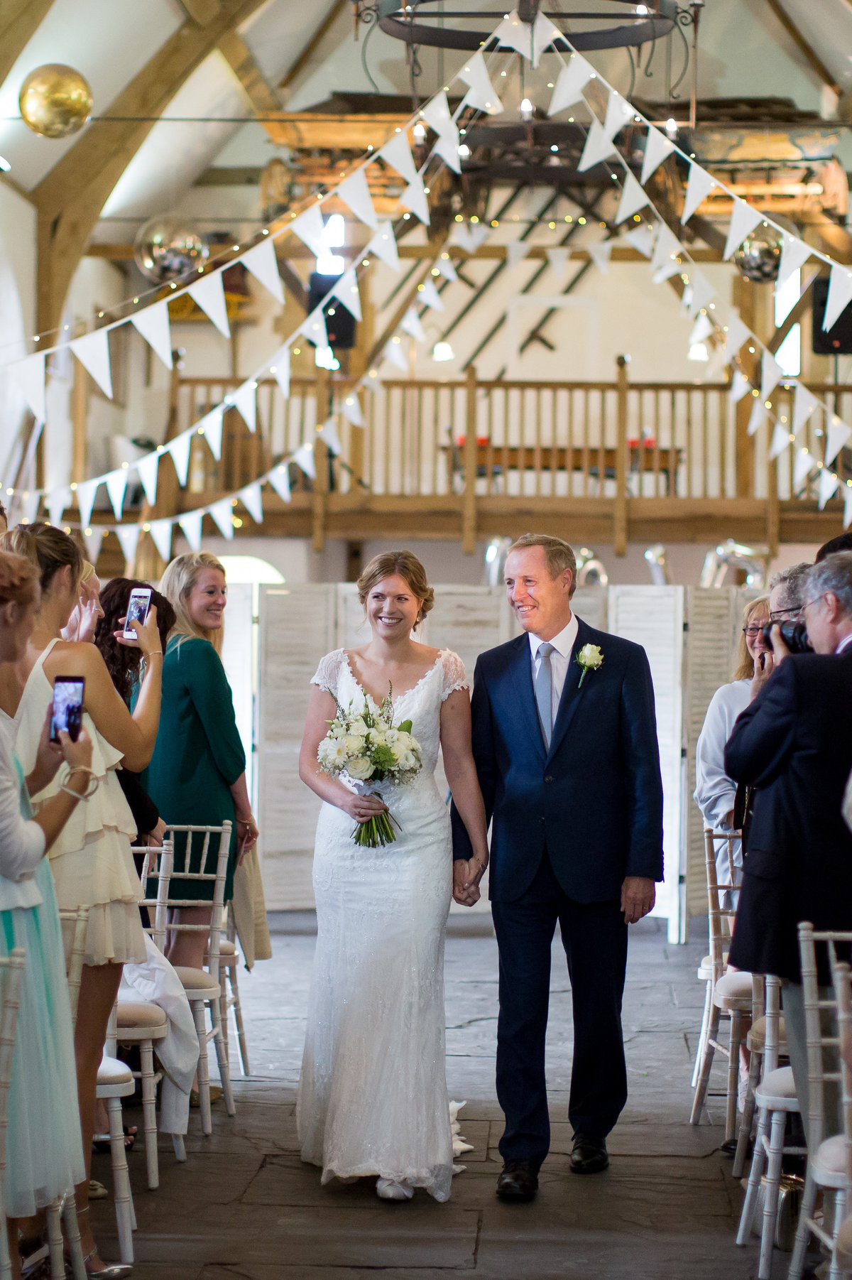 bride and dad walking down the aisle at haselbury mill