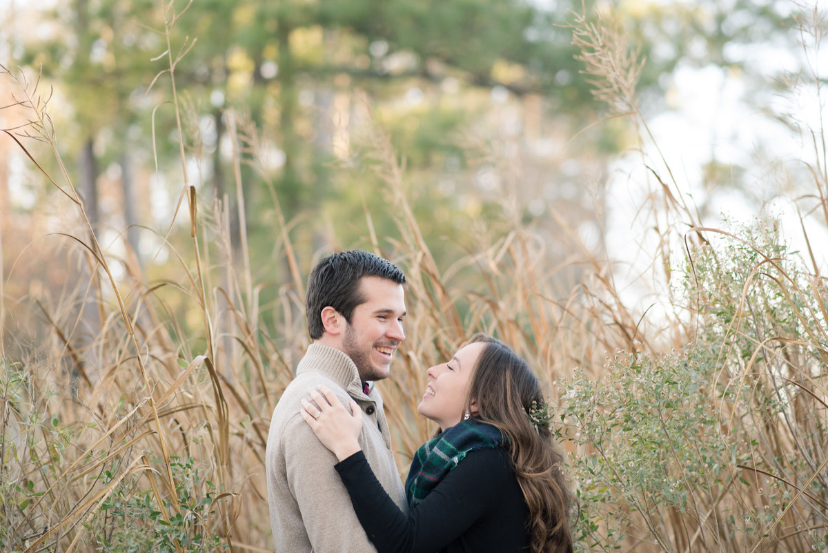 couple laughing during engagement session at windsor castle park by smithfield virginia photographer