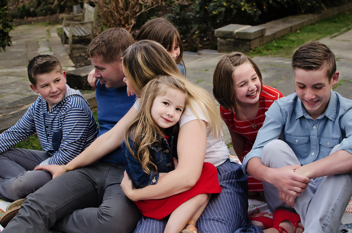 Portrait of a happy family sitting together at Glenview Mansion in Rockville, Maryland taken by Sarah Alice Photography