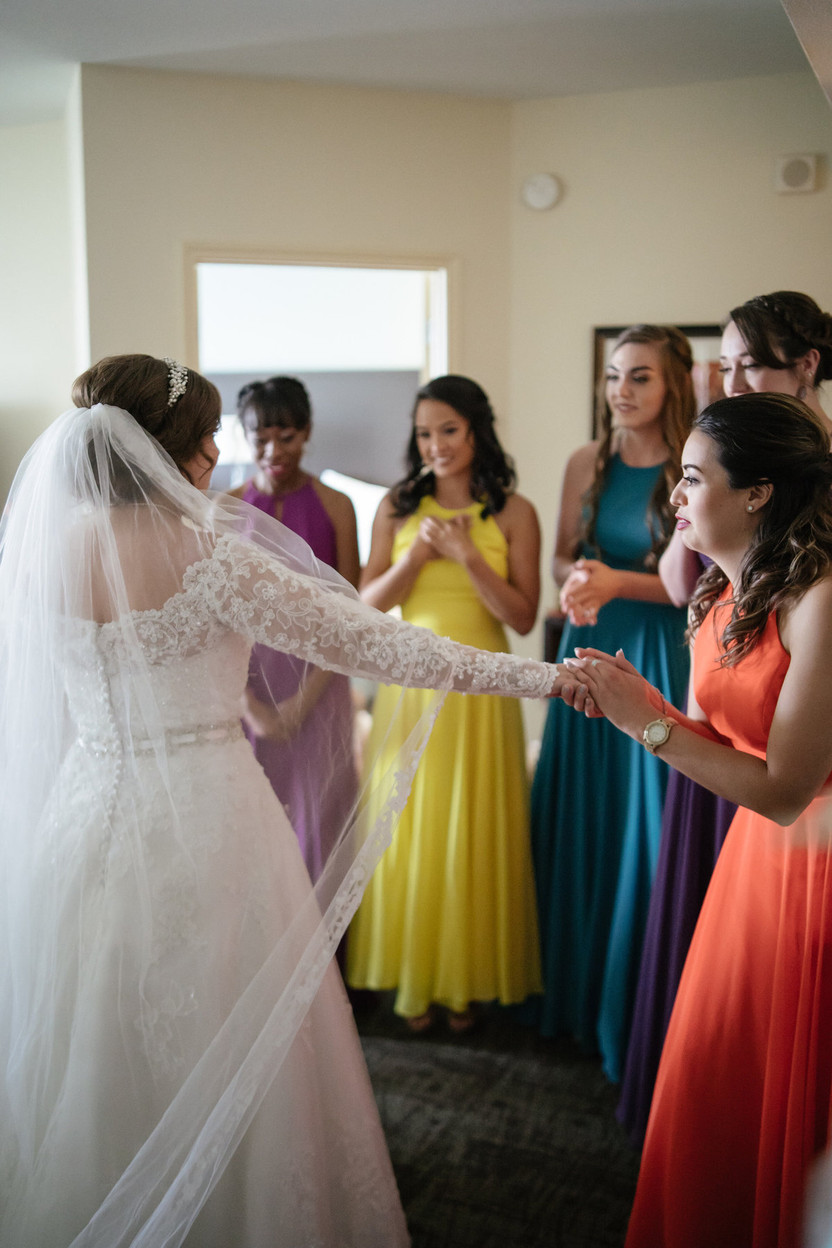 bride has first look with her bridesmaids after getting ready before wedding ceremony at The Spire downtown San Antonio