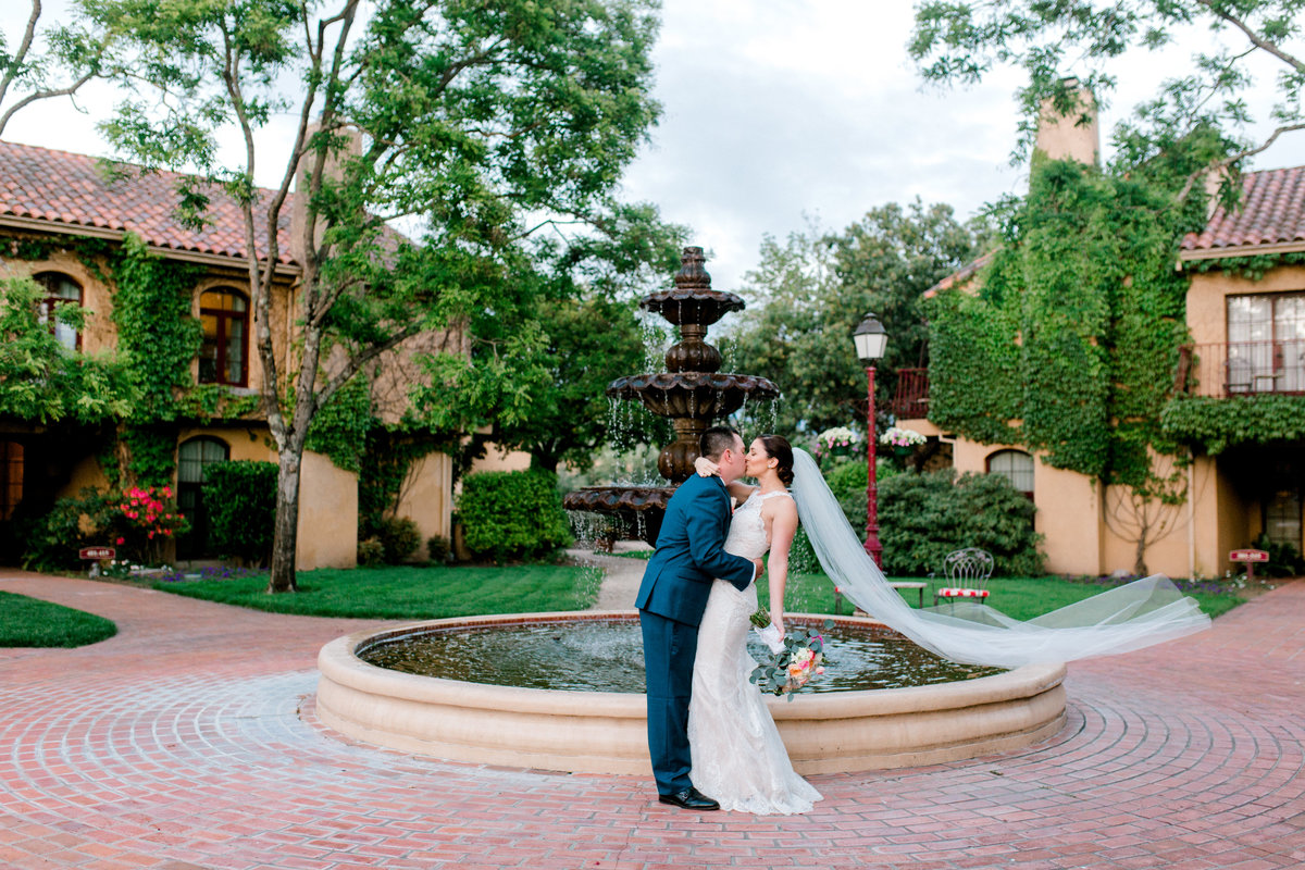 Bride and groom in courtyard with fountain at Vintners Inn in Santa Rosa California