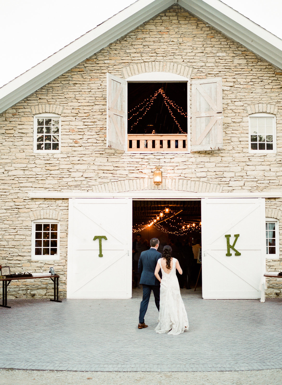 couple enters their reception mayowood stone barn rochester minnesota