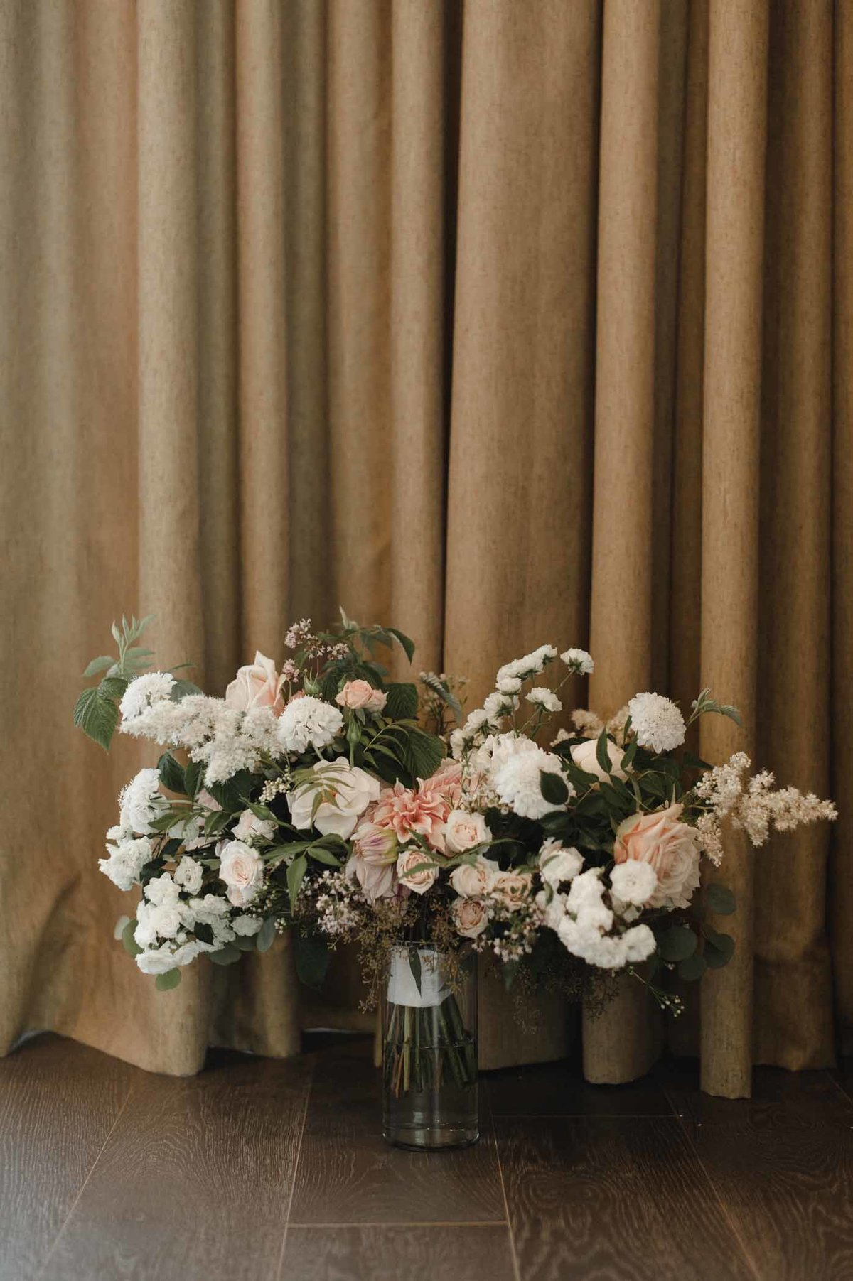 Stunning summer cream and blush  bridal bouquet of Fairy roses, astilbe, roses, and scabiosa.