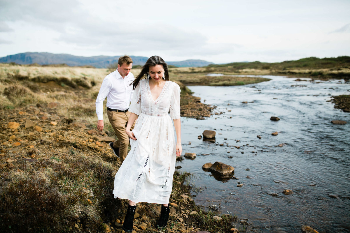 the adventurous couple explores a riverbed during their iceland elopement