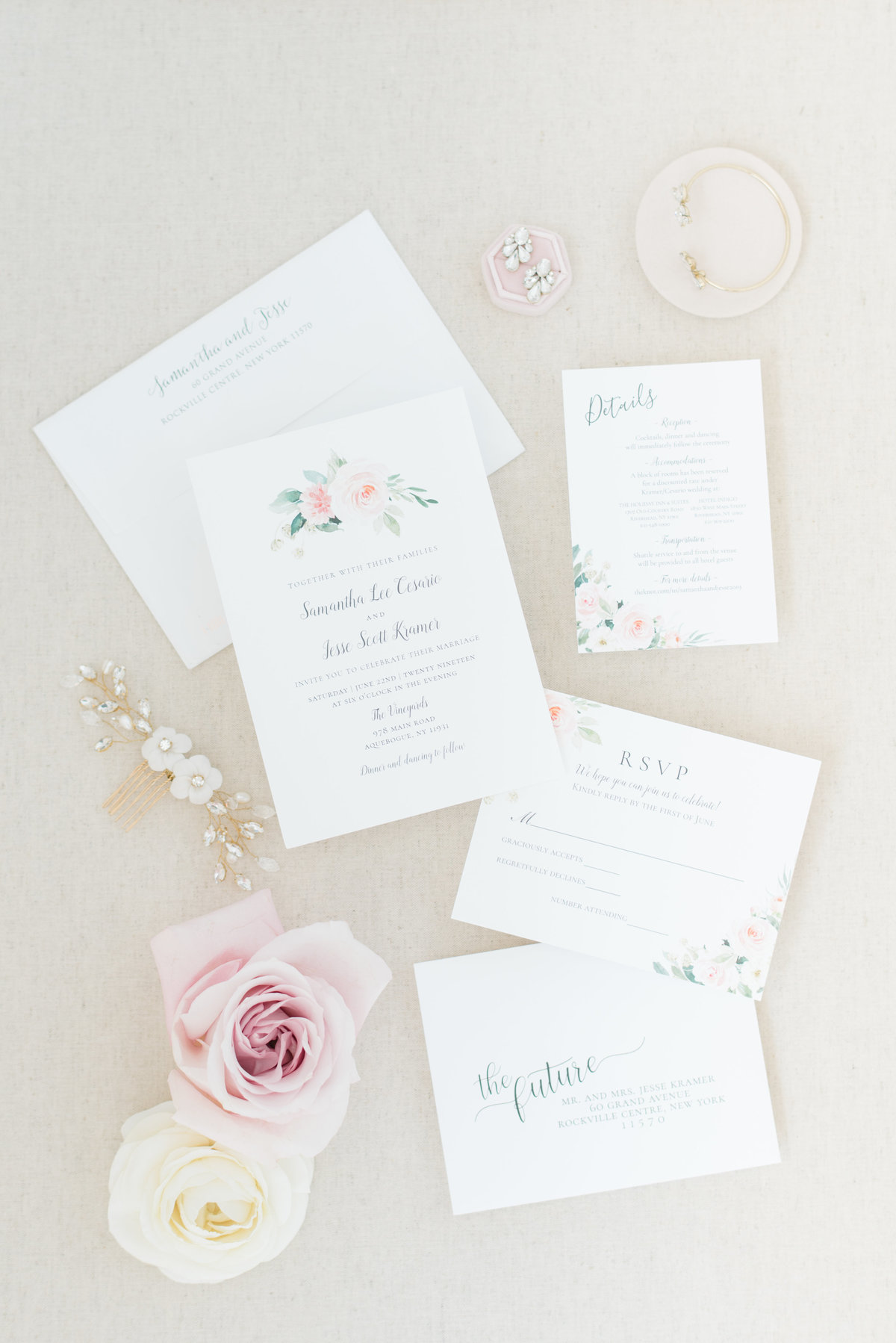 wedding-invitations-with-flowers-on-styling-board