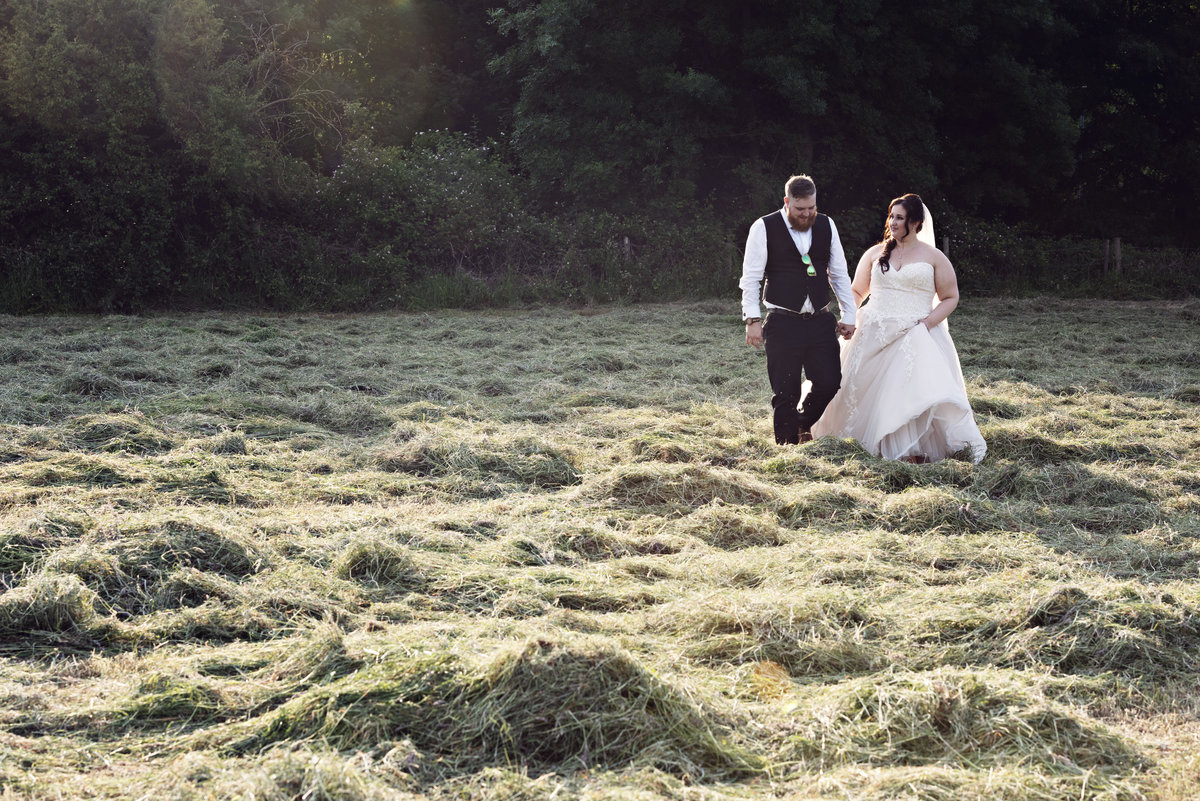 A Bride and Groom in the fields at Sunset at Statham Lodge Cheshire