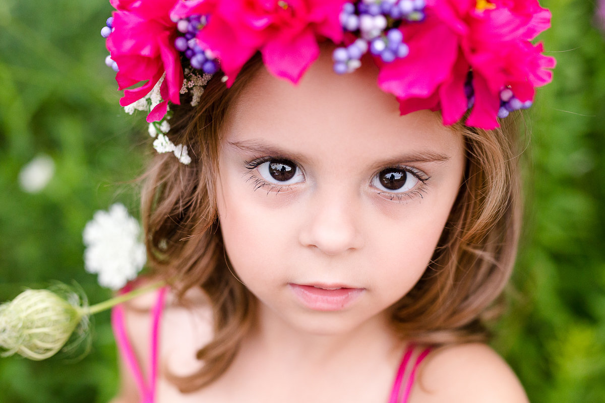 close up of four year old girl looking at camera outdoors {Mississauga Child Photographer}