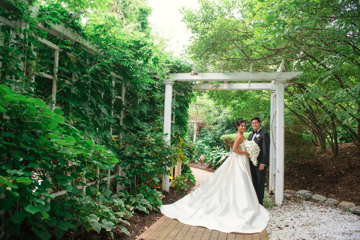 photo of bride and groom in the outdoors gardens for wedding reception at The Garden City Hotel