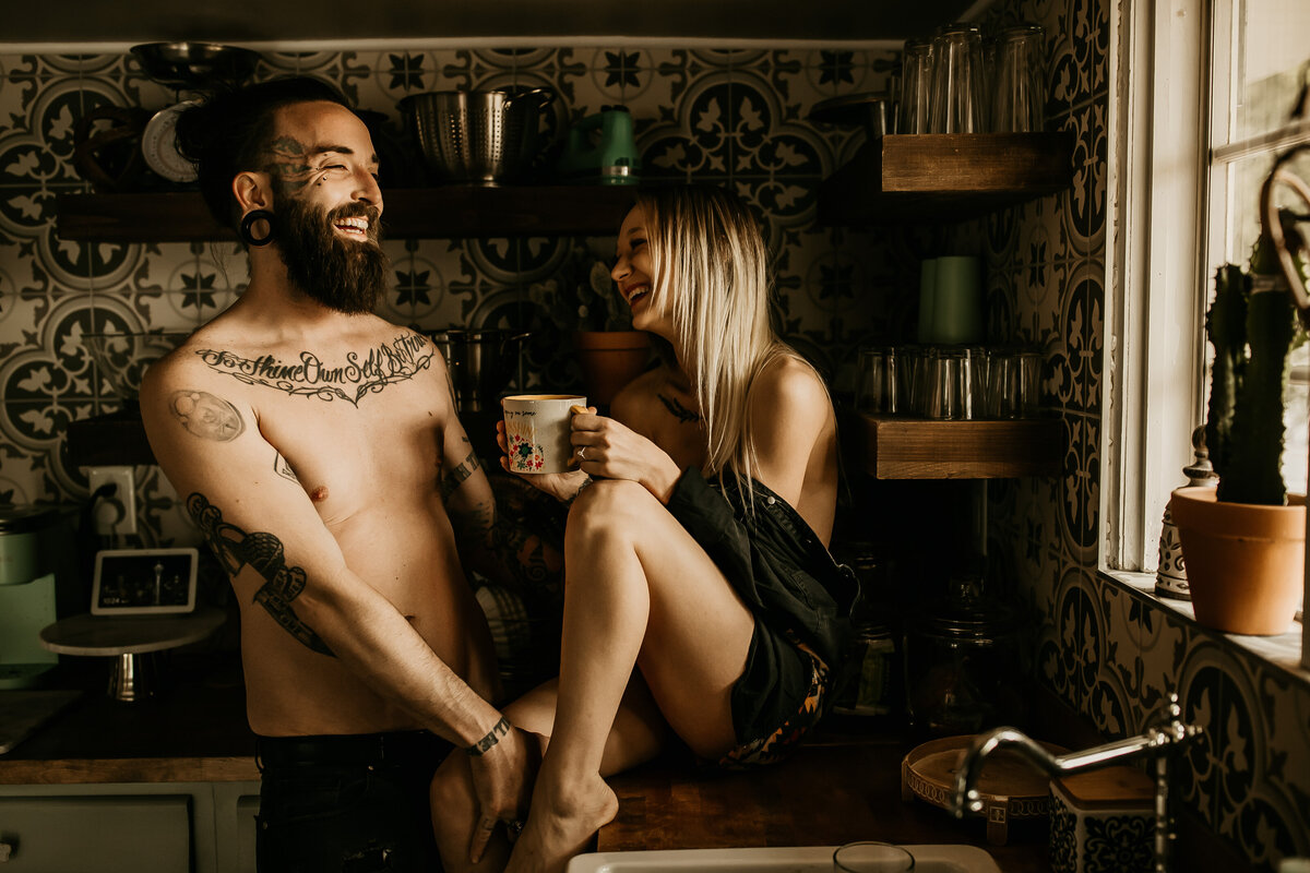 couple hanging out in kitchen