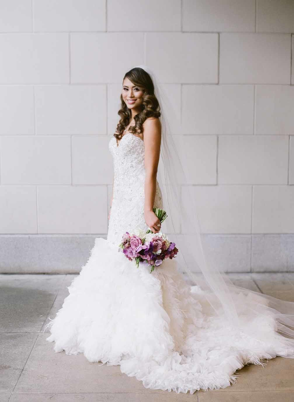 Beautiful bride with purple wedding bouquet