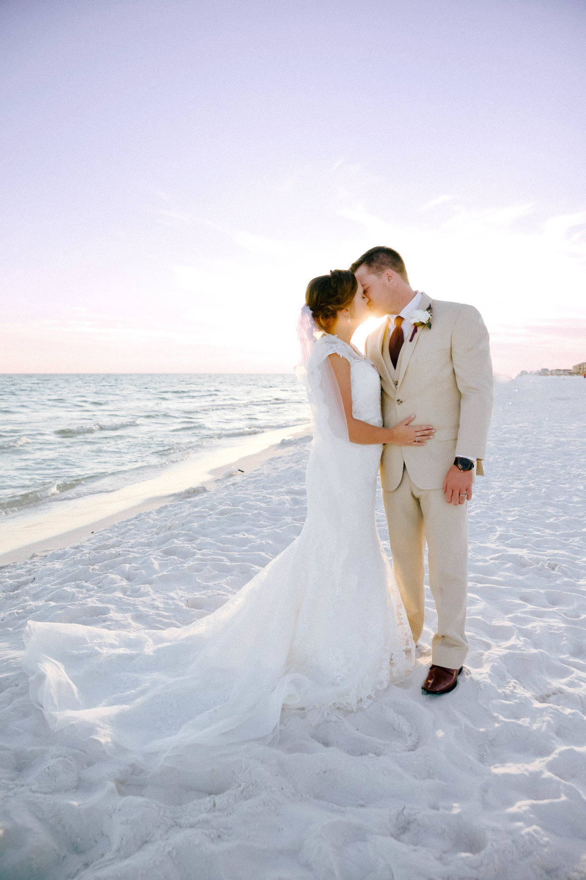 Perfect sunset picture of bride and groom kissing on the beach in Destin, FL