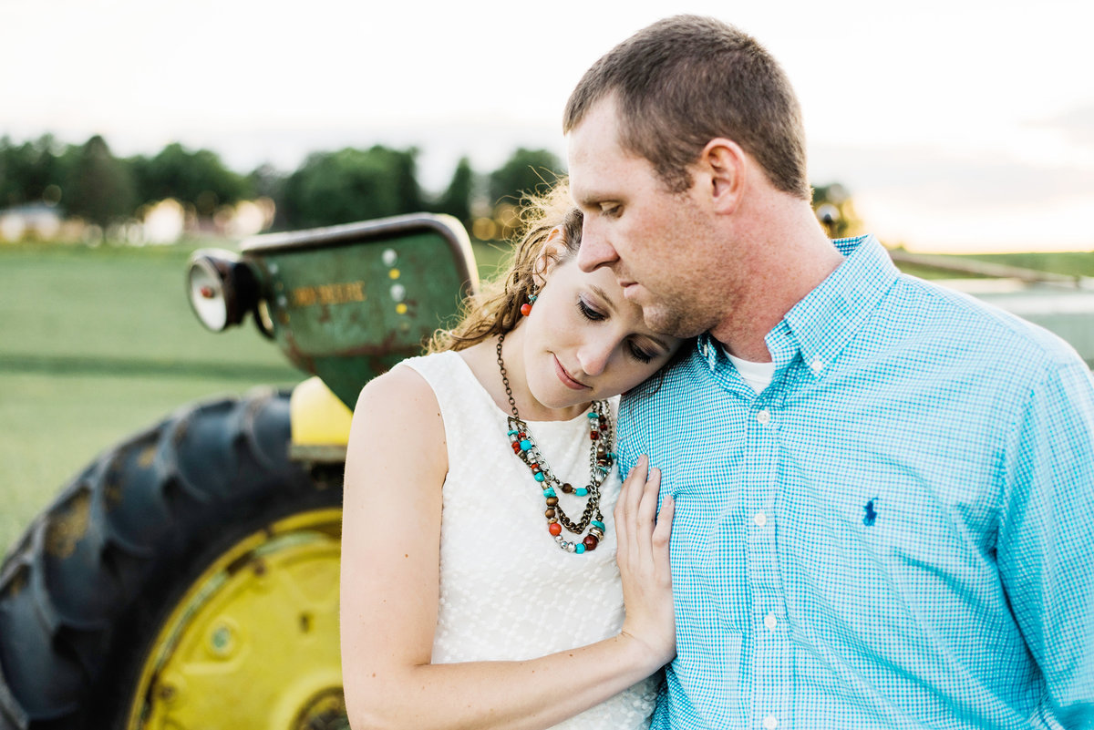 country engaged couple with a tractor