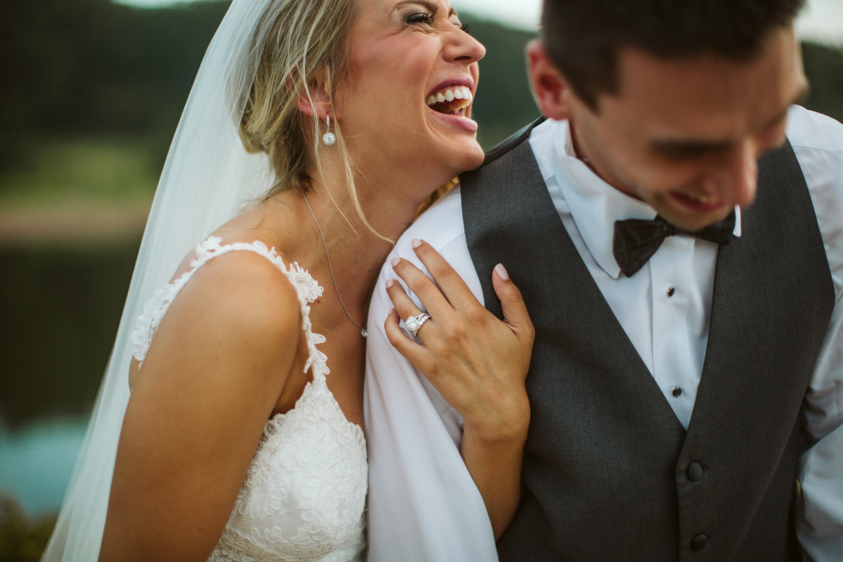 Laughing Bride and groom at orchard ridge farms