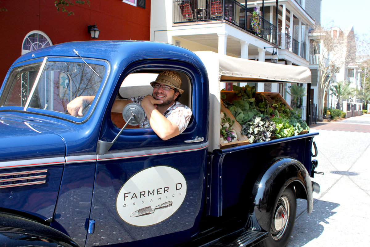 Farmer D in his old school produce truck at Longleaf Preserve Market in Sandestin, FL 2011