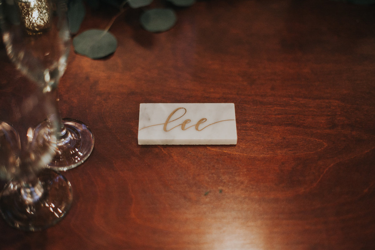 wedding reception hand calligraphy marble tiles as placecards at The Fig house
