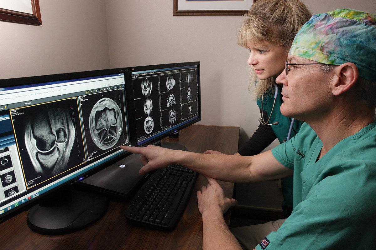 Dr. Langer viewing MRI scans with technician