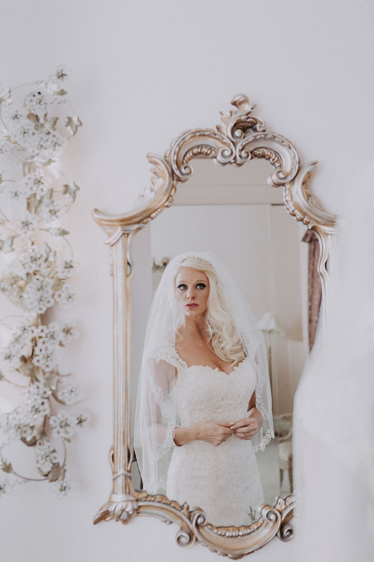 Lake Tahoe wedding photographers bride admires self in ornate mirror
