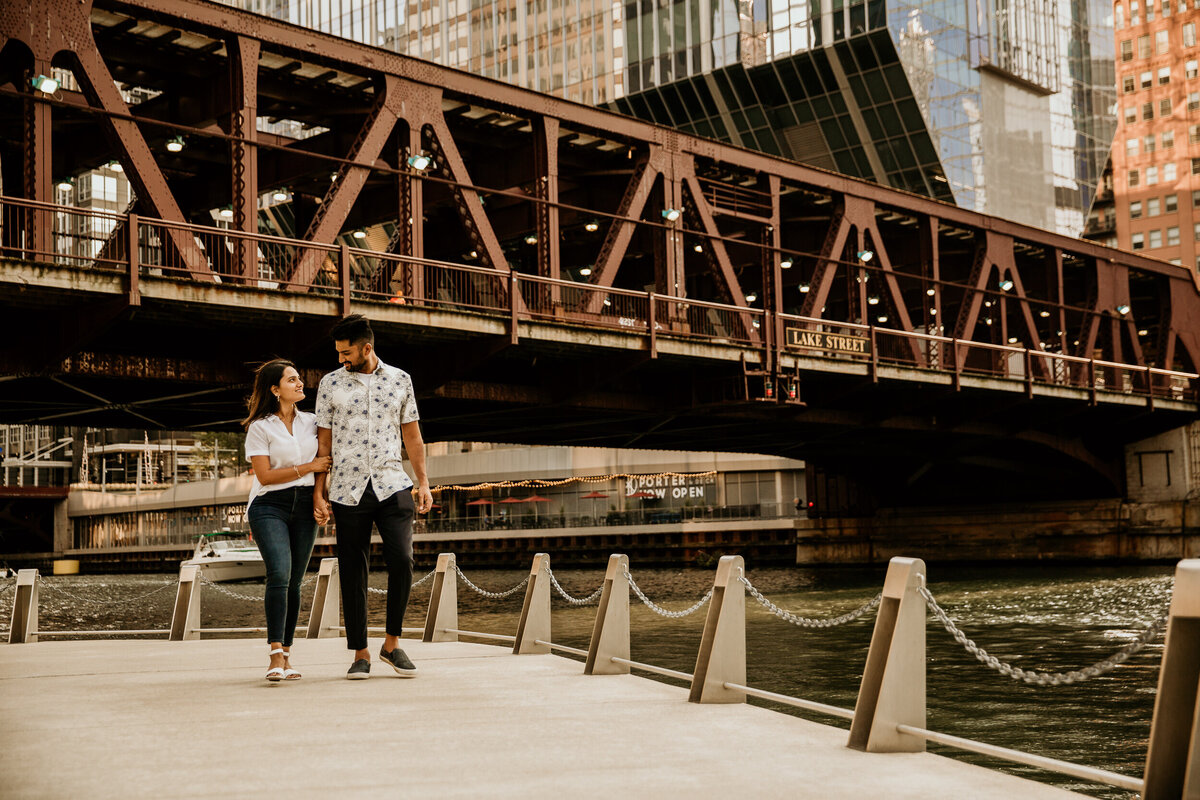 chicago-river-walk-couple-walking-engagement-photos