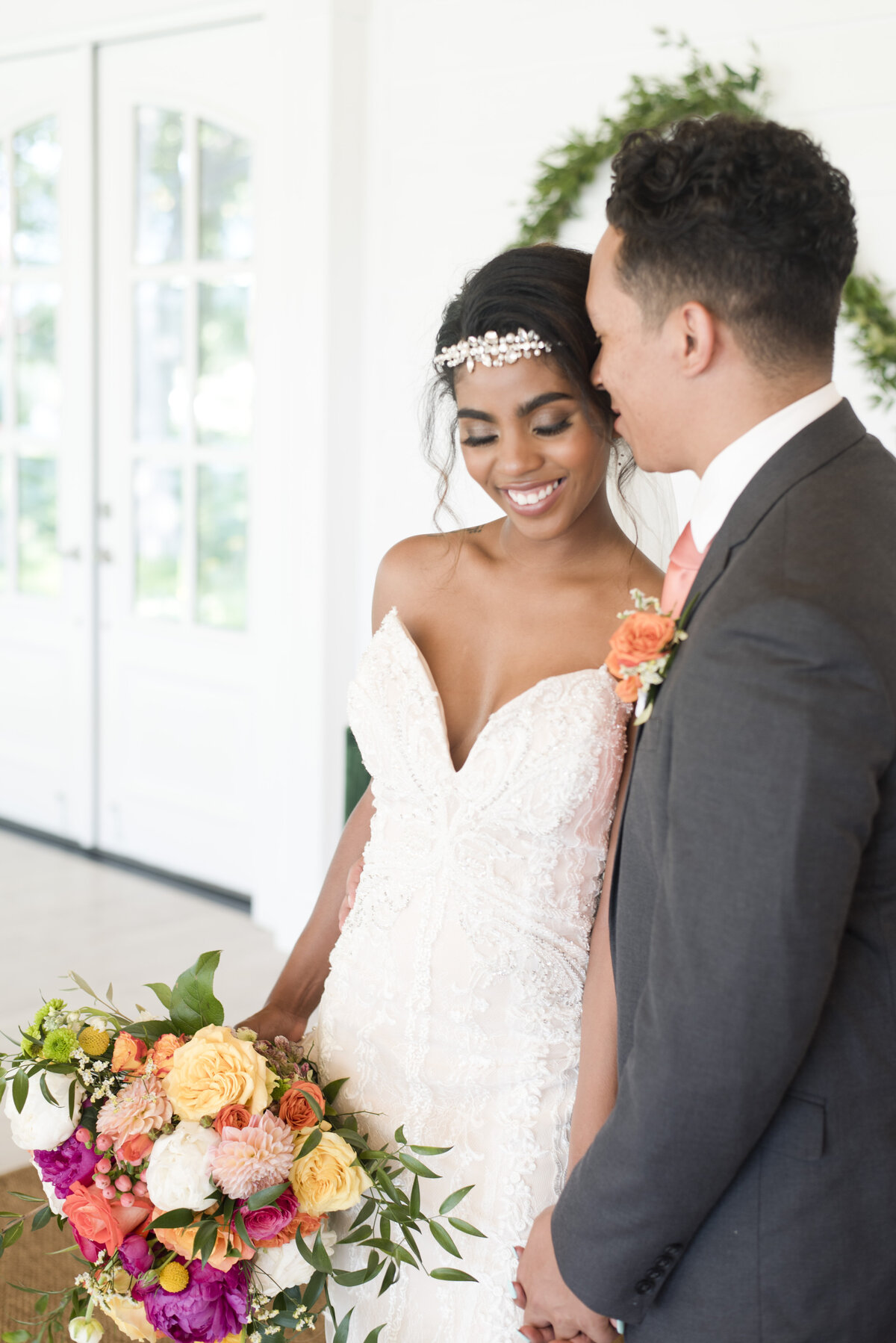 Bride smiling in Fort Worth Wedding venue with colorful bouquet of flowers