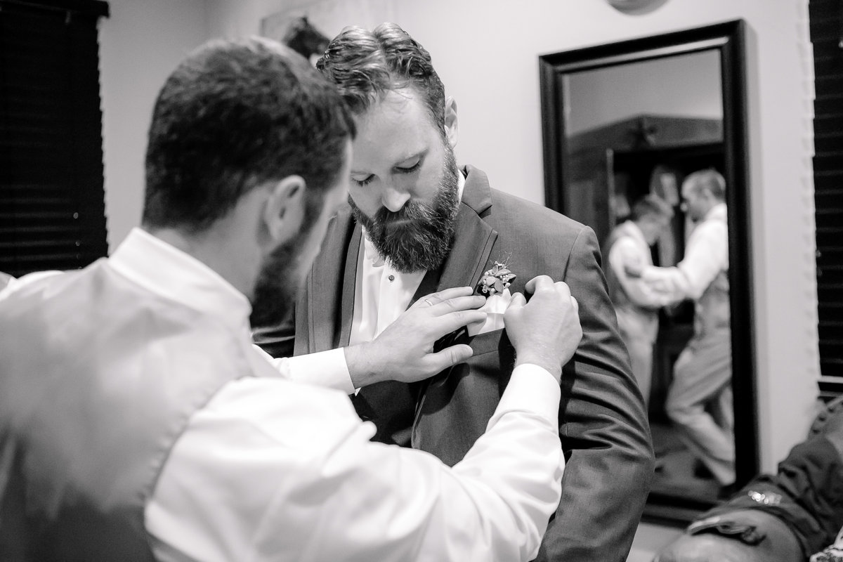 Austin Family Photographer, Tiffany Chapman Photography groom getting flowers pinned photo