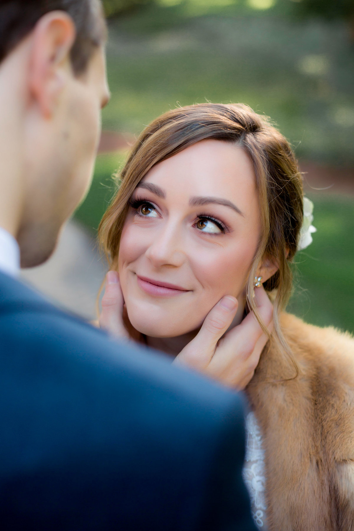bride and grrom looking into each others eyes for first look while wedding photographer captures moment