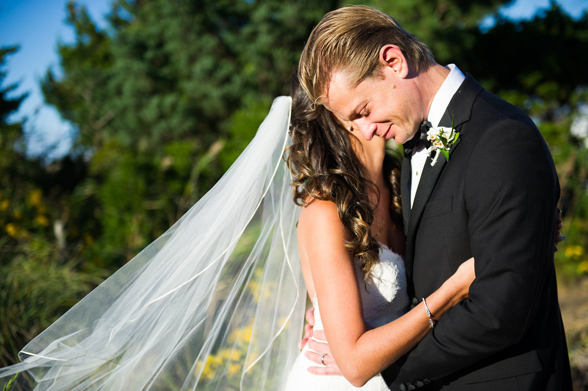 bride and groom share emotional moment