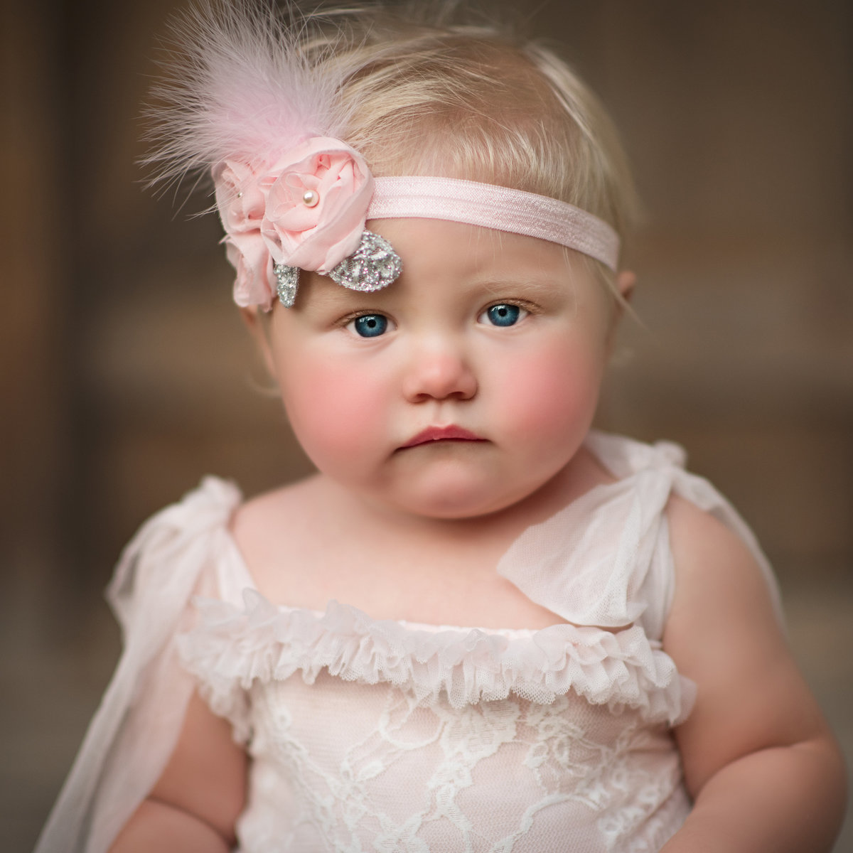 Photo of a baby girl in romper for her first birthday photos Ellensburg Washington