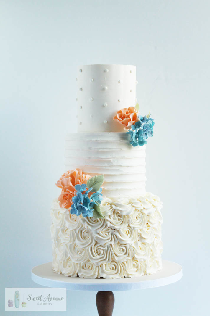 textured buttercream wedding cake with buttercream rosettes and sugar flowers, Hamilton ON wedding cakes